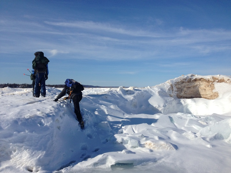 Climbing up the ice and onto the beach on North Manitou Island.