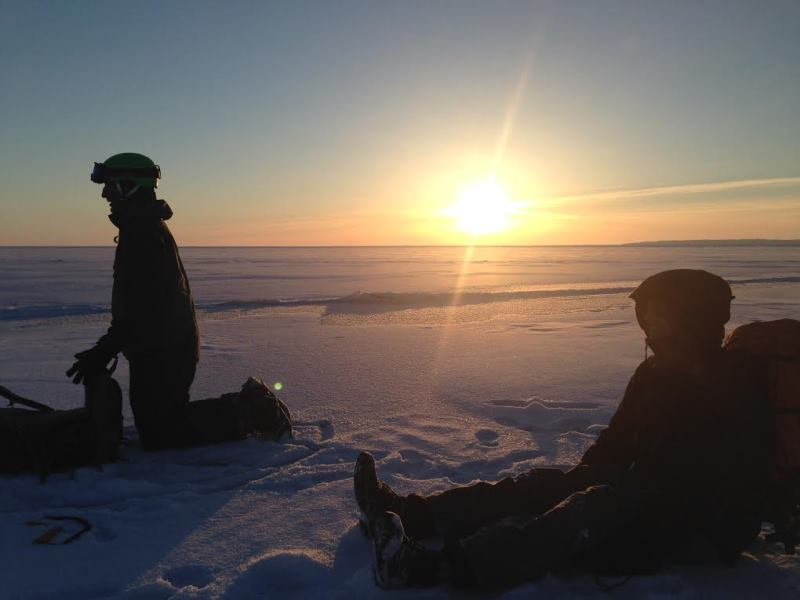 A setting sun and a well-deserved rest out on the ice on Lake Michigan